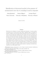 Identification of structural models in the presence of measurement error due to rounding in survey responses